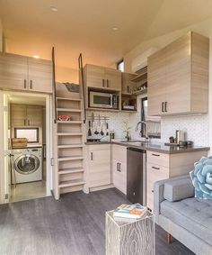 Nest Tiny House - Tiny Living In the kitchen you'll find a cu. refrigerator, two burner cooktop, and a convection microwave. There is a pull-out peninsula for extra counter space and two folding stools tucked behind the stairs. Tiny Loft, Tiny House Loft, Tiny House Living, Tiny House Plans, Tiny House Design, Tiny House Stairs, Tiny House Bedroom, Tiny House Storage, Espace Design