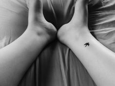 A tiny swallow tattoo. Swallows represent journey, traveling, sailing, exploring etc.