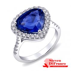 03c05b90c A gorgeous one-of-akind ring featuring a shield shaped sapphire accented by  an exquisite diamond halo. Coast Diamond available at Silverscape Designs.