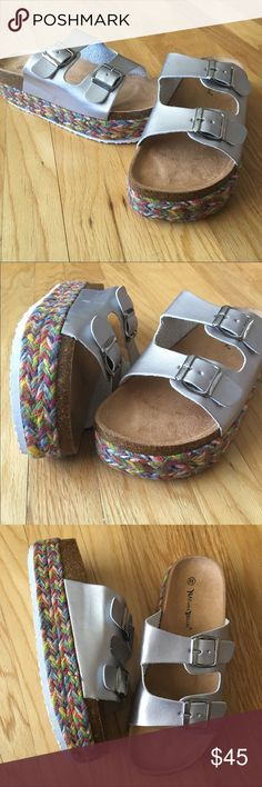 "Silver Slide Sandals Step right in to these super comfy platform sandals. Everyday, casual coffee morning trips, great with shorts, dresses, beach....any summertime fun! Company size chart: 8.5 USA, 9.75"", 2"" platform, man made. Boho style edges! Double buckles, too cute 30% off Bundles Shoes Sandals"