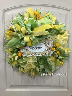 Spring Tulip Welcome Wreath Just look at this wreath makes you want to smile! in diameter and full, filled with lilies and tulips amid colorful ribbons of green, white and yellow. Now available in my Etsy shop today. Wreath Boxes, Diy Wreath, Wreath Ideas, Poinsettia Wreath, Floral Wreath, Tulip Wreath, Easter Wreaths, Christmas Wreaths, Wreaths Crafts