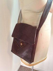 Custom Flynn leather satchel from Tangled