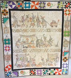 """My """"Mystery of the Salem Witch's Quilt Guild Quilt, along with Show & Tell panel in the border & 1 one the back by Crabapple Hill patterns."""