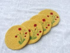 Set of 4 yellow wool felted coasters  by Susietoos