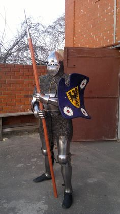 "Лаборатория ""Хранители"" Knight 1450-1400 15th century  Ready for the tournament or tilt  Bascinet helmet whit chain mail armor and plate armor  Shield with holly roman empire simbol"