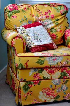 Chintz is back but not like our mothers, one chair, a couple of pillows.....