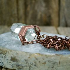 This ice clear quartz point pendant on a pure copper chain is amazing for all chakras and amplifies energy.