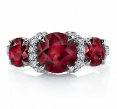 Omi Prive ring set in platinum with 2 Round Rubies and a total of 66 Round Diamonds. Stunning!