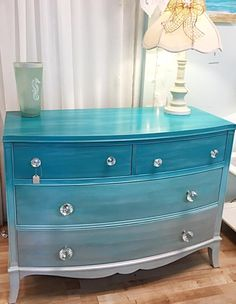 Solid mahogany dresser restores and updated with umbre blues and glass knobs for sale at my House to Home store