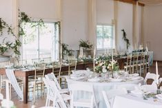 Blue linens, wedding reception, table setting, vintage candles, gold frames, barn reception, september wedding, gold chairs, white chairs, wedding inspiration, wood table, greenery