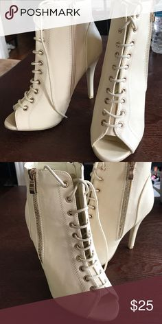 Light beige peep toe lace up ankle boots lk Yeezy Size 7 pair of very light bone vanilla colored ankle boots. Three inch + heel; no platform, these are single sole. Lace up the front through 12 eyelets. Gold zippers on the outside (more for show but functional) and zippers in inside for easy on/off. These are super knock offs of the Yeezy style boots that Kim Kardashian and Kylie Jenner wear. Minimal wear on soles, no scuffing on boots. Shoes Heeled Boots