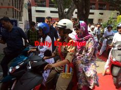 CM Mehbooba Mufti taking scooty ride in Gandhi Nagar College ...Excelsior\photo