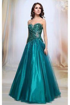 Společenské šaty Francesca Luxusní šaty vhodné na plesy i jiné společenské události, slečny maturantky v nich zcela jistě zazáří. Dlouhé plesové šaty v nádherné a velmi výrazné smaragdově zelené barvě, dokonale padnoucí korzet celý pošitý třpytivými flitry a kameny, vzadu na šněrování, aby skvěle přilnul k postavě. Sukně se skládá z více vrstev, takže dobře drží tvar (spodní lesklá saténová, pevnější tylová, saténová a vrchní tylová pošitá od pasu také flitry). Zapínání na zip v zadní části…