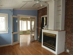 Another view of the blue sun room.  The fireplace is going to get used a lot!