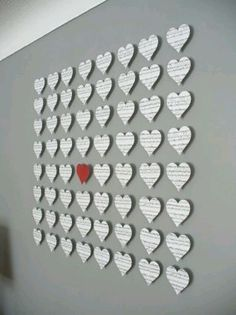 Newspaper heart with one red heart decorated on the wall.