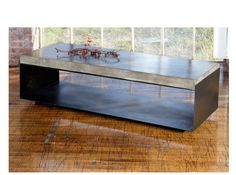 "U-BASE COFFEE TABLE    Sheet steel bent into a simple ""U"" shape and topped with our eco-concrete SLAB. Top available in gray, ivory, umber and corn.         Powder coating optional; various colors available         63""L x 24""D x 18""H"