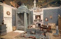 The Queen's Bedroom. The hangings of this right royal apartment in the Queen's Dolls' House are of silk damask, the carpet is woven, and the ceiling is delightfully painted by Glyn Philpot, R.A.