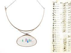 MAD Blog » L: Margaret De Patta, Pendant, c. 1959, gold, crystal, amethyst, emerald, sapphire, and resin.
