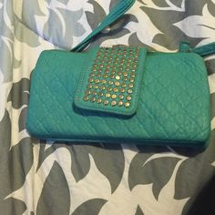 A pretty light green Wallet! A pretty light green wallet! I bought two years ago from a retail store It is still in great condition has some wear but still not so bad! I think you would love it Bags Wallets