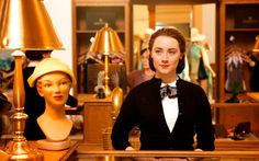 """Saoirse Ronan as """"Eilis Lacey"""" in BROOKLYN. Photo by Kerry Brown. © 2015 Twentieth Century Fox Film Corporation All Rights Reserved"""