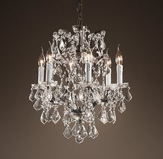 "19th C. Rococo Iron & Clear Crystal Round Chandelier 18"" DIMENSIONS Overall: 18¼"" diam. Minimum Height: 31½"" Maximum Height: 100"" Canopy: 4¾"" diam., 3¼""H Chain: 72""L Chandelier Body: 21¾""H Weight: 14 lbs."