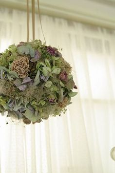 Large hanging foam ball decorated with moss and dried flowers