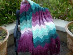 A vintage 1960s 1970s shades of green and purple chevron design granny afghan handmade fringed blanket throw