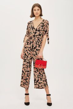 977a231d19 Jumpsuit in a daisy print with cap sleeve detail and cropped legs. Topshop  Online