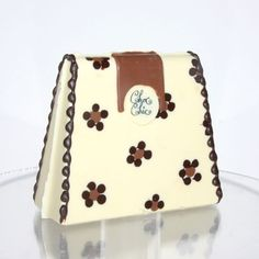 that cake looks like a cute purse!