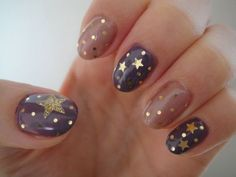 Muted tones sparkly star nails