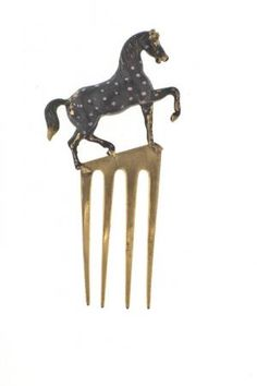 'Horse' Hair Pin by Elsa Schiaparelli (produced by Jean Schlumberger). Gilded and enameled metal. Circa 1936-1939. Les Arts Décoratifs, Paris.