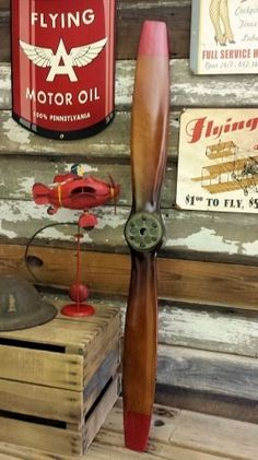 """Whoever said """"good things come in small packages"""" must have been thinking about this scaled down replica of a vintage wood propeller. Hand carved and stained in a beautiful two-tone French Antique finish with mild antiquing, it measures approximately 47 inches and is designed to fit seamlessly into any aviation themed décor. Painted red tips and an antiqued bronze hub plate make this an authentic looking replica propeller, at a price for most budgets.Comes with mountinghardware for wall…"""