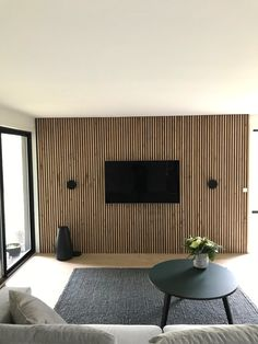 It's easy to install your TV on the slat wall. All you need to do is to either cut a whole for the TV or install it on top of the panels. This is the Akupanel - Rustic Natural Oak. Wood Slat Wall, Wooden Panelling, Wooden Wall Panels, Wood Panel Walls, Wooden Walls, Tv Walls, Home Room Design, Living Room Designs, House Design