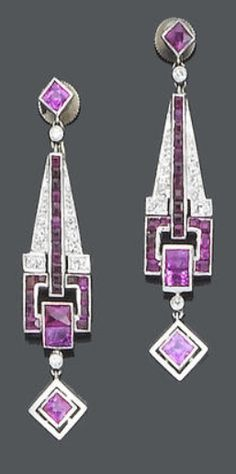A pair of art deco ruby and diamond pendant earrings, circa 1925 Each French-cut ruby suspending a tapering articulated drop set with French and calibré-cut rubies and single-cut diamonds, terminating with a French-cut ruby swing drop, length 4.3cm., fitted case by Johnson Walker  Tolhurst