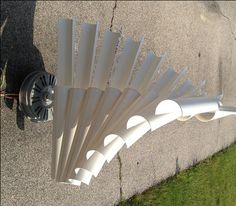 Instructables DIY wind generator using PVC and an old dryer motor--probably easier to just build your own generator, but more expensive...