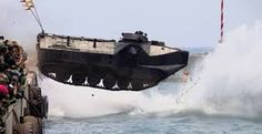 Add a Pin An Indonesian Marine tank slam dunk and jump to the sea during The 70th Republic of Indonesian Military Anniversary on October 2015 in Cilegon Indonesia.