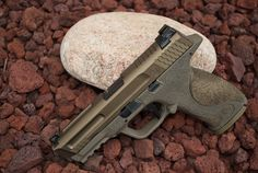 Smith & Wesson M&P VTAC. Customized by Iron Forge LLC... Milled slide, frame stipling. Cerakote colors Magpul FDE (frame) and Burnt Bronze (slide). http://www.ironforgellc.com/services.html