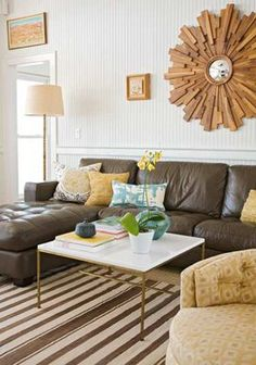 Brown Couch, Yellow, Blue, Teal, Striped Rug, Gold/White Coffee Table with Legs, Starburst Mirror, Floor Lamp
