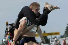 Wife carrying competition in Sonkajarvi, Finland. Not making this up, that country be crazy.