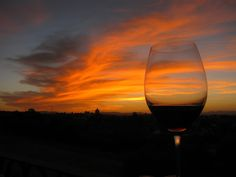 Home to take a calming moment to sip a little wine on the deck and admire the always beautiful sunset before walking across the street to the amphitheater.