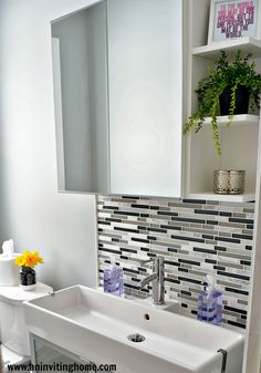 small ikea bathroom i love the narrow but wide sinkcabinet and glass tiles in between the sink and mirror
