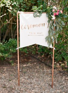 Pretty canvas wedding ceremony sign: http://www.stylemepretty.com/2016/01/26/blogger-bride-jessye-of-city-tonics-colorful-diy-wedding/ | Photography: Ruth Eileen - http://rutheileenphotography.com/