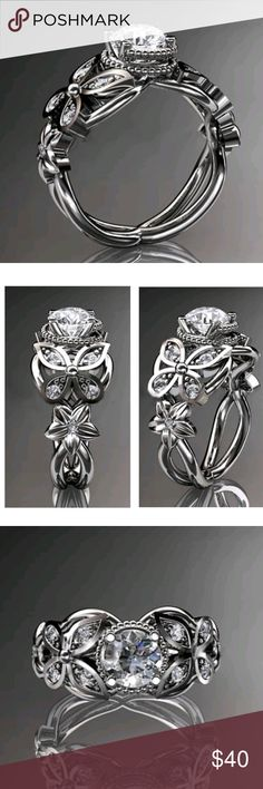 BEAUTIFUL FLOWER AND BUTTERFLY RING NEW FLOWER AND BUTTERFLY RING WITH AAAA ROUND CENTER ELEMENT AND ACCENTS ALONG THE SIDES, HIGH QUALITY  CRAFTSMAN SHIP IN EVERY DETAIL! THIS RIBG IS 18K WGP SIZE 9 includes black velvet gift box Jewelry Rings