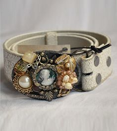Vintage buckle by designer Chelsey Loren is crafted from one of a kind antique and vintage jewelry pieces. This buckle is adorned with 40s pearly cameo, 40s beaded cluster and faux pearls and 40s hand painted floral cameo oval. Shown on a white crackled leather strap. Enjoy your fashionable piece of wearable art!