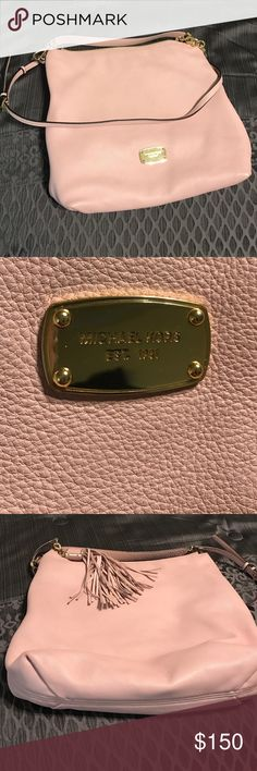 Authentic Michael Kors Blush purse Hardly used Authentic Michael Kors shoulder bag. Color is a gorgeous brush pink. The shoulder strap is detachable to make it into a hobo hand bag. No blemishes in the outside leather. The inside is HUGE, it has a large zipper compartment, and 4 pockets. The inside has a very small light blue stain, possibly from an ink pen. There is also a super cute tassel attached (which is not removable). This purse is PERFECT. I just don't carry enough stuff to need…