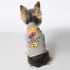 Cool rockin' dogs dig this stylish t-shirt featuring a flaming purple skull wearing a punk rock dog collar.