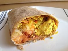 A vegan breakfast burrito stuffed with tofu scramble, hash browns, and cheddar? Two words: Heck. Yes.