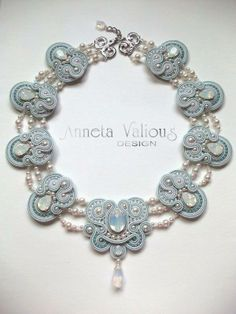 Anneta Valious   ***   The bottom blue design looks like a butterfly.  Make one somewhat like it as a pin or brooche.
