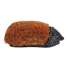 Esschert Design - Giant Hedge Hog Boot Brush - Poor Hedgehog, always getting the boot. Actually, this one appears to enjoy the attention. Your new hedgehog boot brush will cheerfully get into one scrape after another, all while keeping his tough coconut fiber coat — and your boots and shoes — looking good.