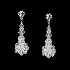 "These stylish drops add detail and sparkle to your look. - 1 ½"" long - Prong-set crystal at the post - Hand woven clusters of Swarovski® crystal - Silver plate rondelles with inlaid stones - Assembled"